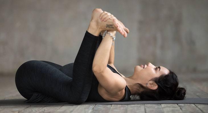 Happy Baby Pose (Ananda Balasana) - yoga poses for sleep
