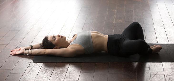 Supine Bound Angle Pose (Supta Baddha Konasana) - yoga poses for sleep